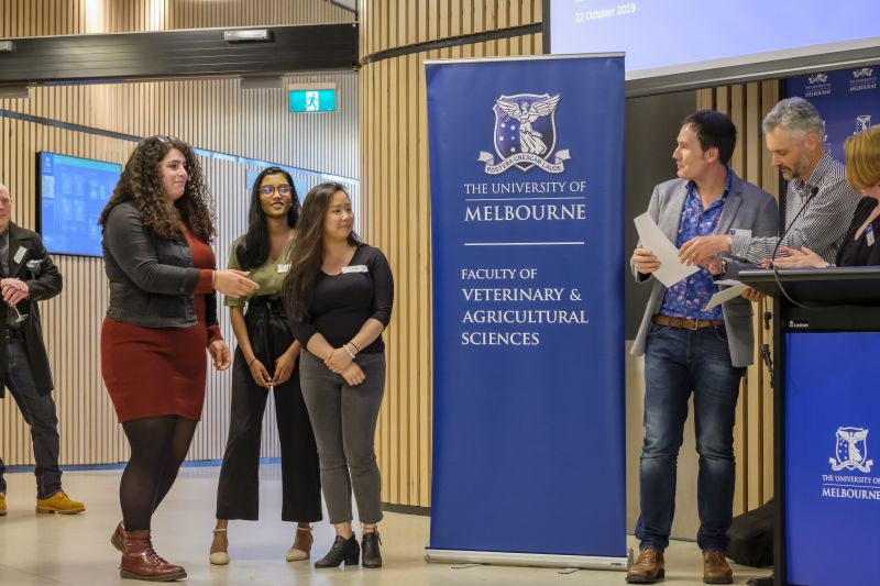Stephanie Veskoukis receives her award from Professor Herbert Kronzucker, followed by Anita Sayampanathan and Nini Hoang. Lecturer Dr Michael Santhanam-Martin and subject coordinator Dr Sarah Frankland are pictured right.