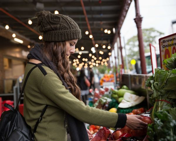 Woman selecting food item in outdoor market