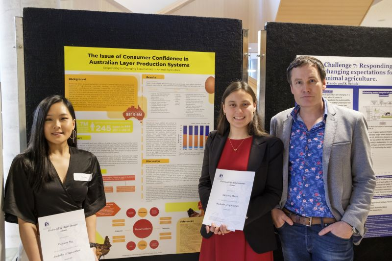 Vivienne Ng and Adrianne Harris, their poster and Head of the School of Agriculture and Food, Professor Herbert Kronzucker.